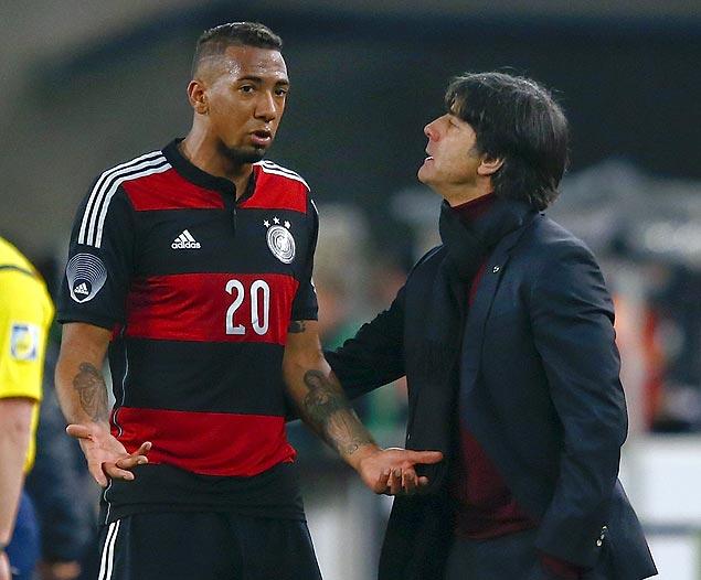 O zagueiro alemão Jérôme Boateng (esq.), que irá enfrentar seu irmão, jogador de Gana, na Copa do Mundo