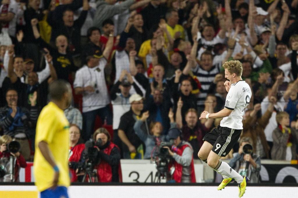 Schürrle comemora gol da Alemanha em amistoso contra o Brasil, em 2011