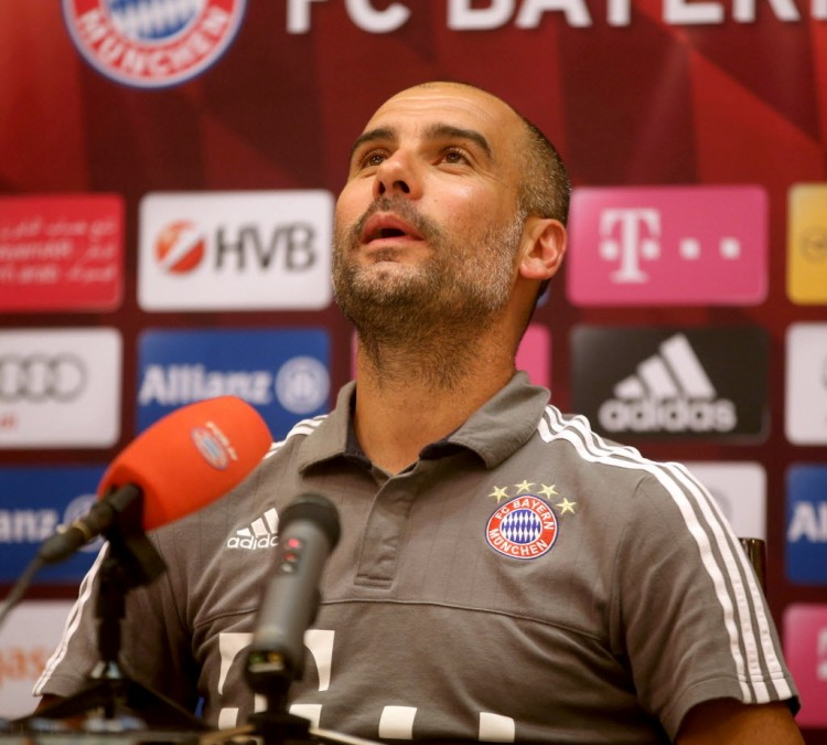 Bayern Munich's Spanish head coach Pep Guardiola speaks during a press conference at Aspire Academ in the Qatari capital Doha on January 11, 2016. / AFP / STRINGER