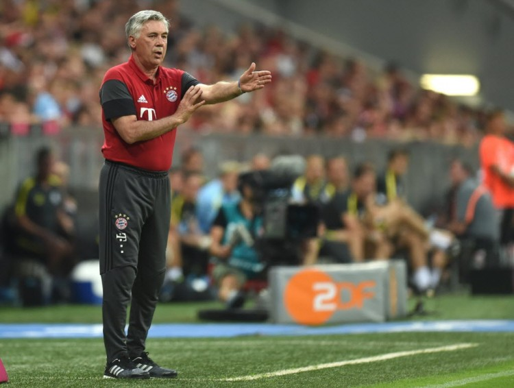 Bayern Munich's Italian headcoach Carlo Ancelotti gestures during a friendly soccer match between the German first division Bundesliga club FC Bayern Munich and the Premier League football team Manchester City in Munich, southern Germany, on July 20, 2016. / AFP PHOTO / CHRISTOF STACHE