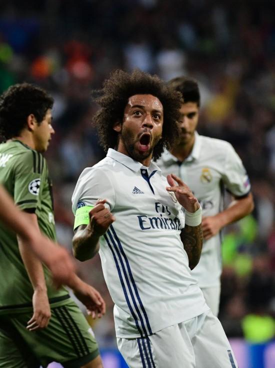 Marcelo, do Real Madrid, a quem Dalbert admira, vibra após fazer gol na Liga dos Campeões da Europa (Pierre-Philippe Msrcou - 18.out.2016/AFP)